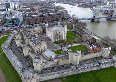 90124617-aerial-view-flying-over-tower-of-london-wall-castle-with-tower-bridge-and-river-thames-in-england-uk
